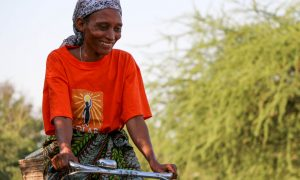 Hilaria Pashcal sells solar lights and clean cookstoves to her community in Tanzania. (Credit: Solar Sisters)