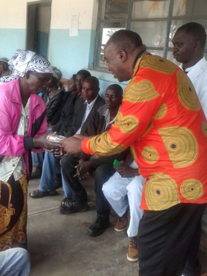 President Kambani Presenting a solar light to a deserving Traditional Birth Attendant