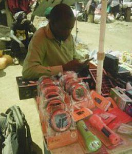 A member selling D. Light S2 Solar Lights at Nairegia Enkare Market – Narok County