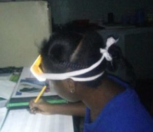 A nurse completing birthing notes by the light of an SM100