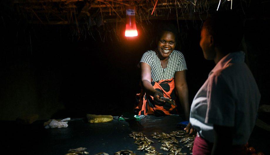 Margaret John in Malawi selling fish after dark.