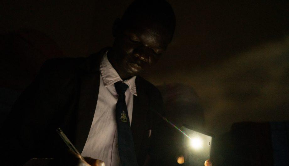William Chris Banda prepares for class