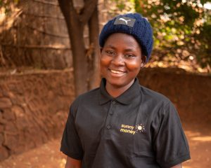 Women stands smiling in Malawi