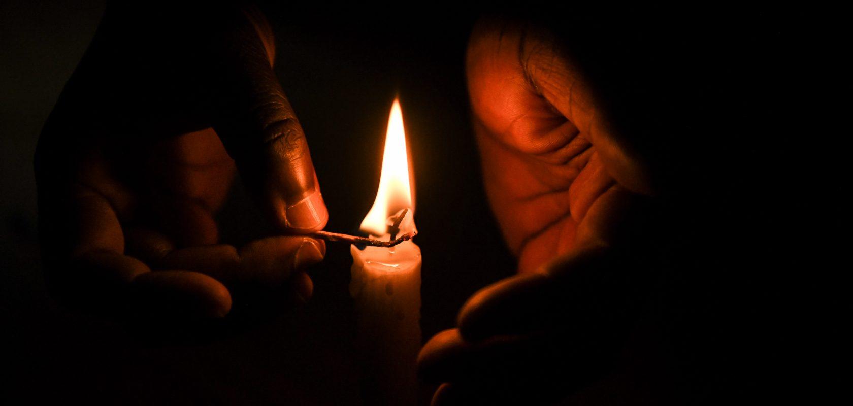 Candle flame in TA Kasakula's hands